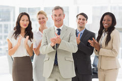 Business team standing and clapping at the camera Royalty Free Stock Photo