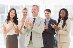 Business team standing and clapping Royalty Free Stock Photo