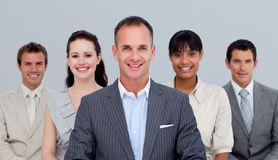 Business team standing in front of the came Stock Images