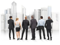 Business team standing in front of a city. Royalty Free Stock Photos