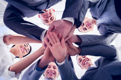 Business team standing hands together. In the office Royalty Free Stock Image