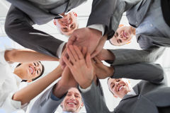 Business team standing hands together Stock Photo