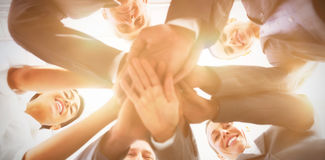 Business team standing hands together. In the office Stock Photo