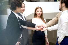Business team showing unity with their hands together stock image