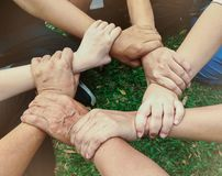 Business team standing hands together people joining for cooperation success business. Teamwork concept stock photos