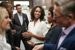 Free Business Team Standing Having Informal Meeting In Modern Office Stock Images - 144596044