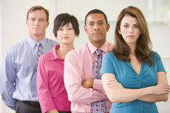 Business team standing indoors Stock Image