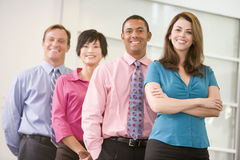 Business team standing indoors smiling Royalty Free Stock Photos