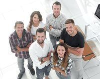 Business team standing near the desktop. View the top. creative business team standing near the desktop and looking up royalty free stock photography