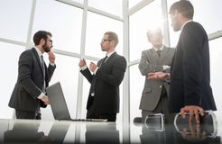 Business team standing in the office of the business center. Office weekdays stock photos