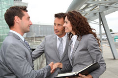 Business team standing outside stock image