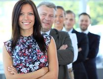 Business team standing in a row. Portrait of a stylish young businesswoman with her successful business team at office Royalty Free Stock Images