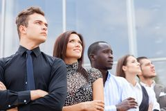 Business team standing in a row at office and looking upwards - Successful business team. royalty free stock photography