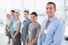 Business team standing in row and smiling at camera Royalty Free Stock Photography