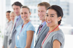 Business team standing in row and smiling at camera Stock Image