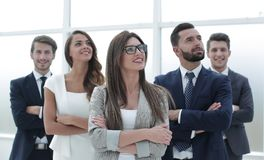Business team standing together and looking at copy space. Stock Photo