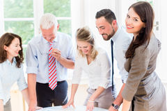 Business team in strategy meeting discussing Stock Images