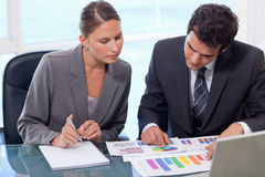 Business team studying statistics Royalty Free Stock Photos