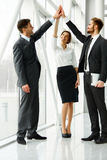 Business Team. Successful Business People Celebrating a Deal Stock Photo