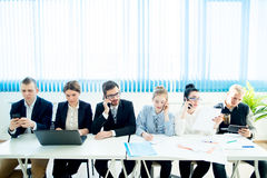 Business team at table Stock Photo
