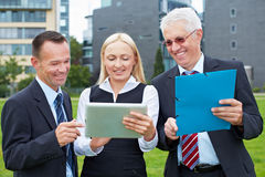 Business team with tablet computer Stock Images