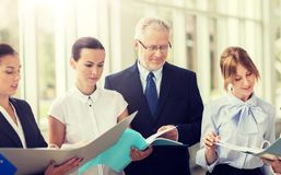 Business team with tablet pc and folders at office royalty free stock images
