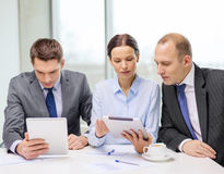 Business team with tablet pc having discussion Stock Photo