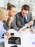 Business team with tablet pc having discussion Royalty Free Stock Photography