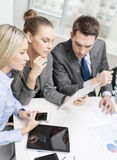 Business team with tablet pc having discussion Royalty Free Stock Images