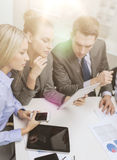 Business team with tablet pc having discussion Royalty Free Stock Photo