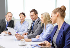 Business team with tablet pc having discussion stock image