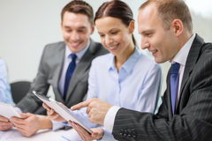 Business team with tablet pc having discussion Royalty Free Stock Image