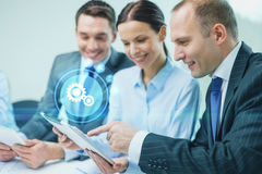 Business team with tablet pc having discussion Stock Photography