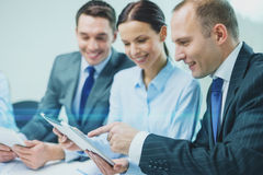 Business team with tablet pc having discussion Stock Photos