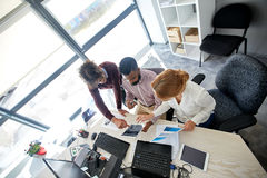 Business team with tablet pc and papers at office Stock Images