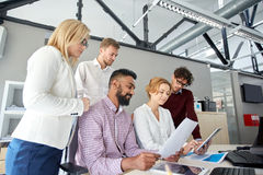 Business team with tablet pc and papers at office Stock Photo