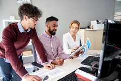 Business team with tablet pc and papers in office Stock Photography