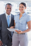 Business team with tablet pc smiling Stock Photos