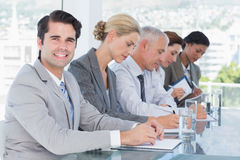 Business team taking notes during conference Stock Images
