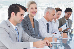 Business team taking notes during conference Royalty Free Stock Photos