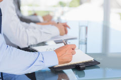 Business team taking notes during conference Royalty Free Stock Images