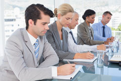 Business team taking notes during conference Royalty Free Stock Image