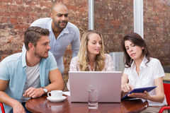 Business team talking and using tablet pc Stock Images