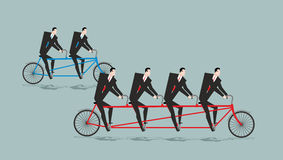 Business team on tandem. Long bike. Many managers. Large company Stock Image