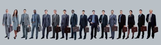 Business team with their  briefcase  in a single line against wh. Business team with briefcase  in a single line against white background Royalty Free Stock Photo
