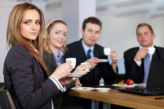 Business team during their coffee break. Business team having a coffee break during their meeting, all hold small coffee cups Royalty Free Stock Photography