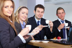 Business team during their coffee break royalty free stock photography