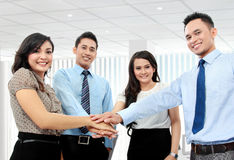 Business team with their hands together. In the office Royalty Free Stock Image