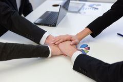Business team with their hands together Stock Photos