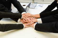 Business team with their hands together Stock Image
